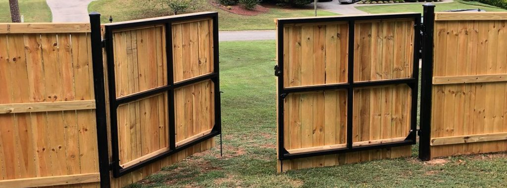 privacy fence with double door wooden driveway gate